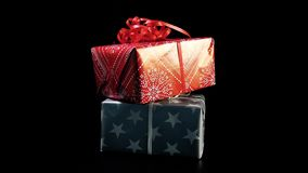 Christmas presents on black backround stock video footage