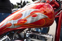 Red and silver customised motorcycle tank. A red and silver custom painted motorcycle tank Stock Image