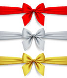Red, silver and gold ribbons with bow  on white backgrou. Nd. Contains the Clipping Path. There is in addition a vector format EPS 8 Stock Images
