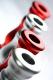 Red and Silver Holders I. Four red and silver circles - top parts of candle holders Royalty Free Stock Photo