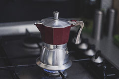 Red and Silver Moka on Stove Stock Image