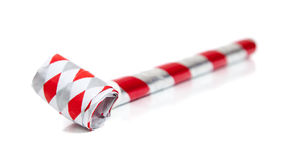 Red and silver noise makers on white Royalty Free Stock Images