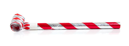 Red and silver noise makers on white Stock Photos