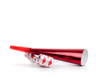 Red and silver noise makers on white Stock Photography
