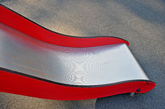 Red and silver slide in the park Stock Images