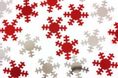 Red and silver snowflakes. On a white background royalty free stock photography