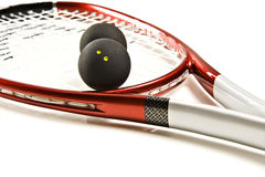 A red and silver squash racket Stock Photos