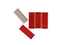 Red and silver staple isolated. Red and silver staple for  stapler isolated with white background Royalty Free Stock Images