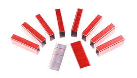 Red and silver staple put as semicircle isolated Stock Photography