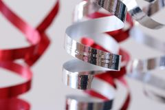 Red and silver streamers party decoration. Ready for celebrating stock photos
