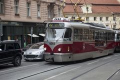 Red and silver vintage tram driving on a street in the city Stock Photography