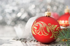 Red and silver xmas ornaments on bright holiday ba. Ckground with space for text Royalty Free Stock Photo