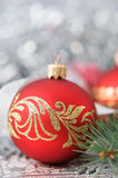 Red and silver xmas ornaments on bright holiday ba Royalty Free Stock Images