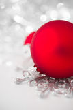 Red and silver xmas ornaments on bright holiday background Stock Images