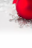 Red and silver xmas ornaments on bright holiday background. Merry christmas Royalty Free Stock Image