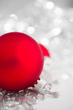 Red and silver xmas ornaments on bright holiday background. Stock Image