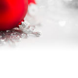 Red and silver xmas ornaments on bright holiday background Royalty Free Stock Photos