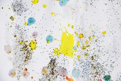 Silver orange yellow pink blue golden sparkling lights, winter paint watercolor background. Red silver yellow pink blue orange golden spots of watercolor hues Stock Photo