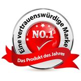 Shiny award ribbon designed for the German retail market. Red and silverish shiny award ribbon designed for the German retail market. Text translation: Trusted Royalty Free Stock Photography