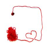 Red skein with heart and ladybird for crochet. On white background Stock Photo