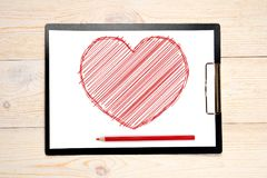 Red sketched heart drawn on paper. Red pencil stock photos