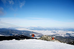 Red  ski lift in ski resort Borovets in Bulgaria .Beautiful winter landscape Royalty Free Stock Photo