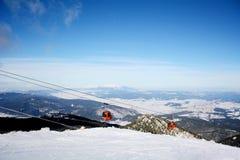 Red  ski lift in ski resort Borovets in Bulgaria .Beautiful winter landscape Royalty Free Stock Photo