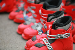 Red ski shoes. Lots of red ski shoes for rent or sell stock image