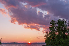 Red Skies at Sunset in the North Woods Stock Images