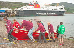 Red Skiff hauled out of the sea. A red skiff,  Partan, hauled out of the sea at Ullapool on the 13 th July 2013 at the end of the World Skiff championship Royalty Free Stock Photo