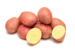 Red skin potatoes. Photograph of potatoes with red and one cut in half. Photographed in studio on a white background Royalty Free Stock Photos