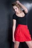 Red skirt and black blouse in studio Royalty Free Stock Photo