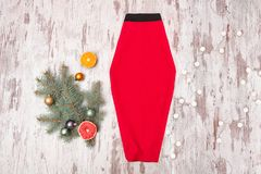 Red skirt, spruce branch and garland on a wooden background. Fas Royalty Free Stock Photo