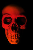 Red Skull Halloween Scare. A scary halloween skull stares at you stock images