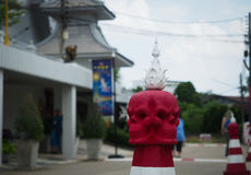 The red skull on the top of traffic cone. The red skull sculpture on the road of the famous place, Wat Rong Khun, Chiangrai Stock Photos
