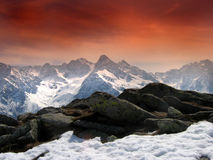 Red sky in the alps. Alpine view with red sky filter effect stock images