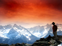 Red sky in the alps. Alpine panorama with red filter stock images
