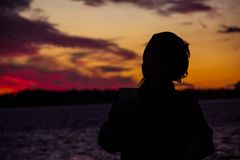 Red sky beduin sunset city. Amazing evening shadow woman watch at the sky red home natural sunset royalty free stock photo