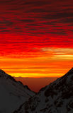 Red sky. Bloody clouds in the mountains red sunset or sunrise stock image