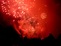 Red sky fireworks 2. Real Red fireworks silhouettting the crowd Stock Image