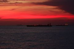 Red sky. Mesmerising sunset with ships in background Royalty Free Stock Image