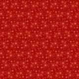 The red sky with orange and yellow stars and snowflakes, texture Stock Photo