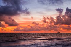 Red sky over Atlantic Ocean coast at sunset Royalty Free Stock Photos