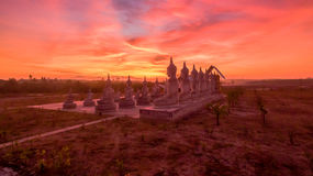 Red sky over buddha statues Royalty Free Stock Photography