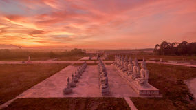 Red sky over buddha statues Stock Images