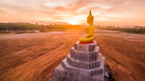 Red sky over buddha statues Royalty Free Stock Photos