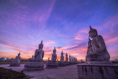 Red sky over buddha statues Royalty Free Stock Images