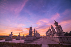 Red sky over buddha statues Stock Photography