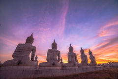 Red sky over buddha statues Stock Photos
