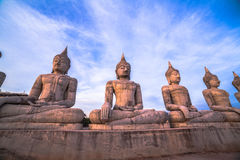 Red sky over buddha statues Stock Image